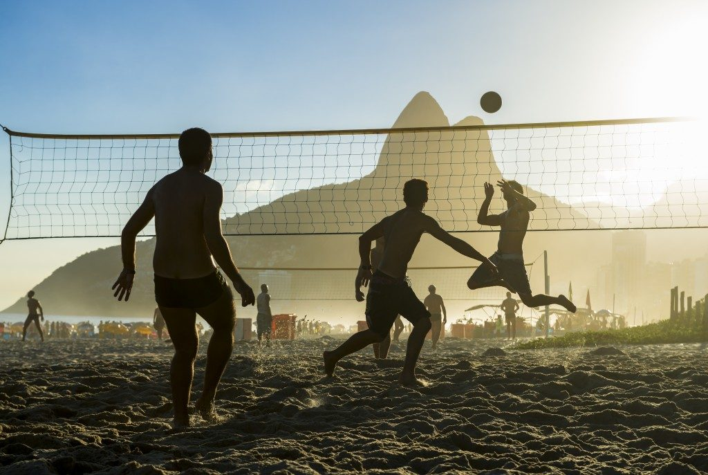 Silhouette of men playing volleyball