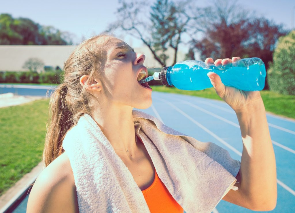 Woman having a sports drink after a run