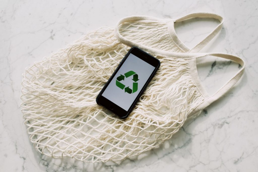 recycle logo on mobile phone with net bag