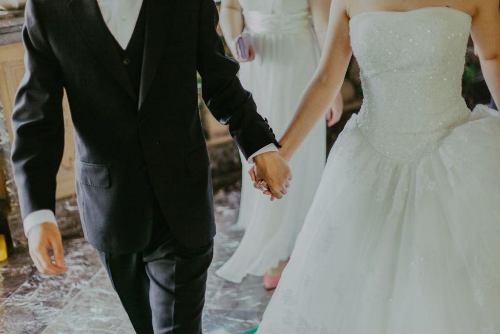 holding hands wedding bride and groom