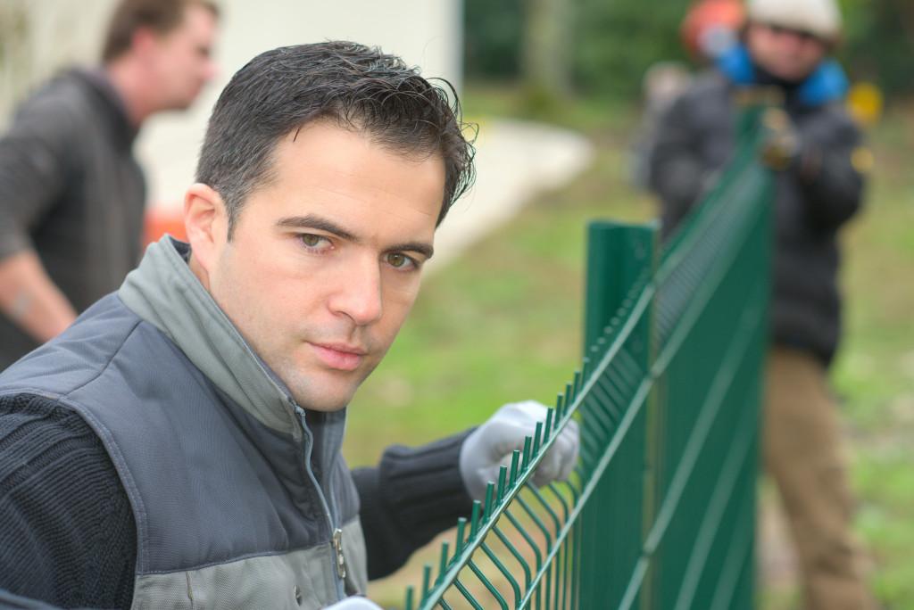men installing a fence