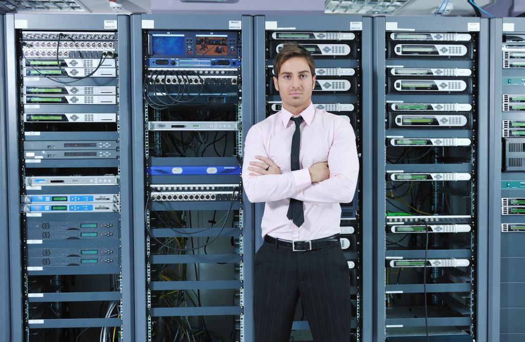 man standing near the database